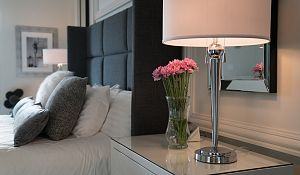 Penthouse master bedroom flowers on side table small